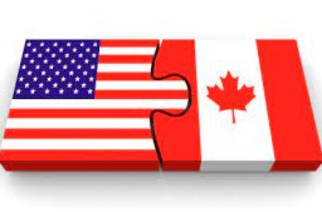 USD/CAD trims weekly losses, approaches 1.2400